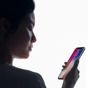 woman using face id with closed eyes