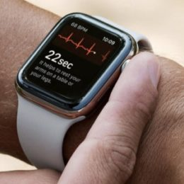 man performing an ecg on apple watch 4