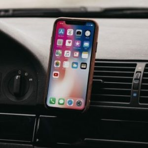 iPhone X connected to car via Bluetooth.